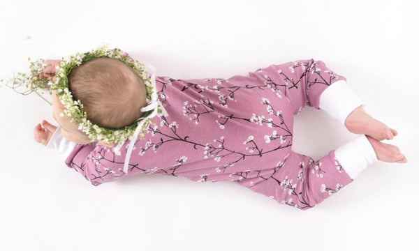 aster & oak organic long sleeve baby zip romper orchid with baby's breath print