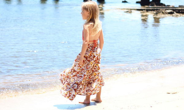 girl on beach wearing flowing melatiku maxi skirt and handmade crochet top