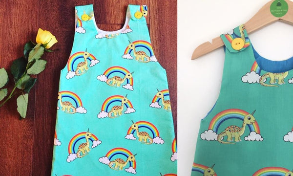 the princess and the frock green girls dress with dinocorns and rainbows