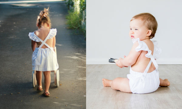 swell & solis girls perwinkle pinafore and white baby romper with ruffles