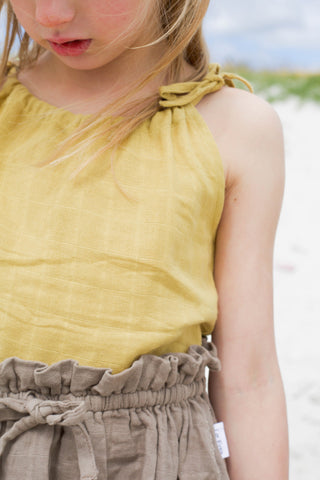 close up of girl wearing le edit marni singlet in sunshine yellow