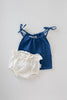 flatlay of le edit blue organic singlet and white bloomers