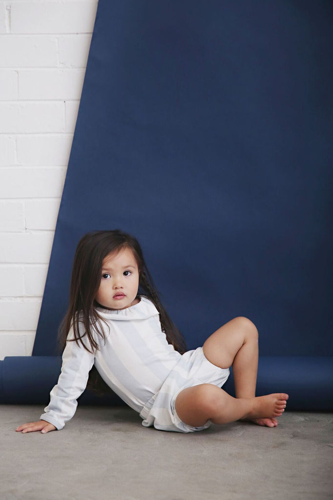 toddler wearing anarkid block stripe organic bloomers and frill neck leotard