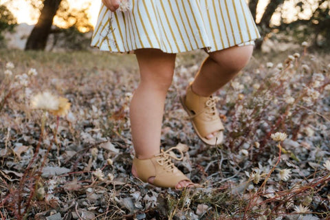 toddler wearing tan leather sandals by anchor & fox
