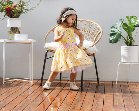 girl wearing oobi yellow diamond flower party dress