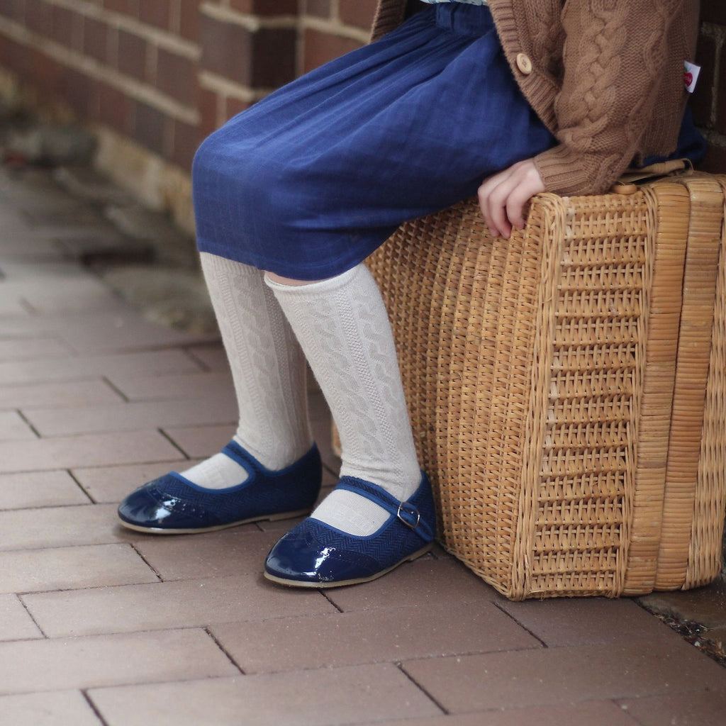 girl wearing navy blue anchor & fox mary janes