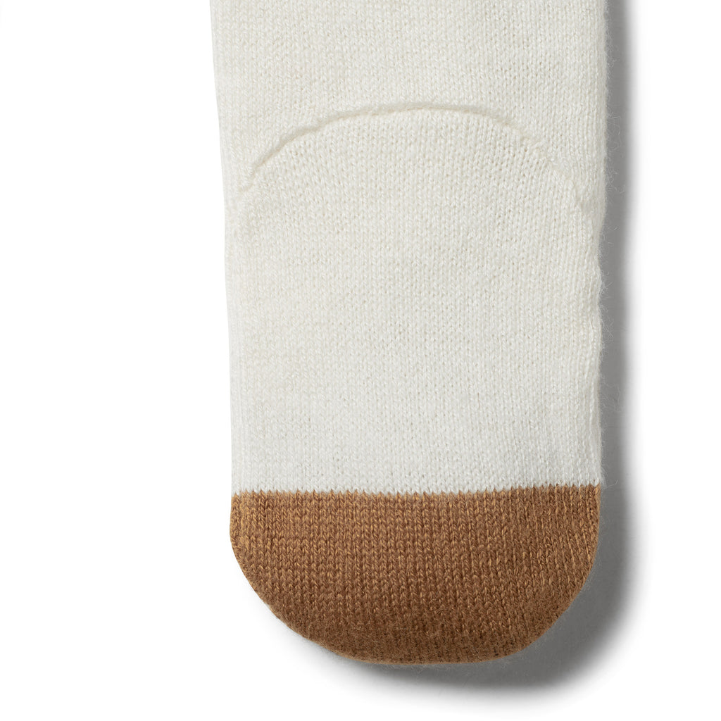 Caramel tip on Wilson & Frenchy knitted baby stocking
