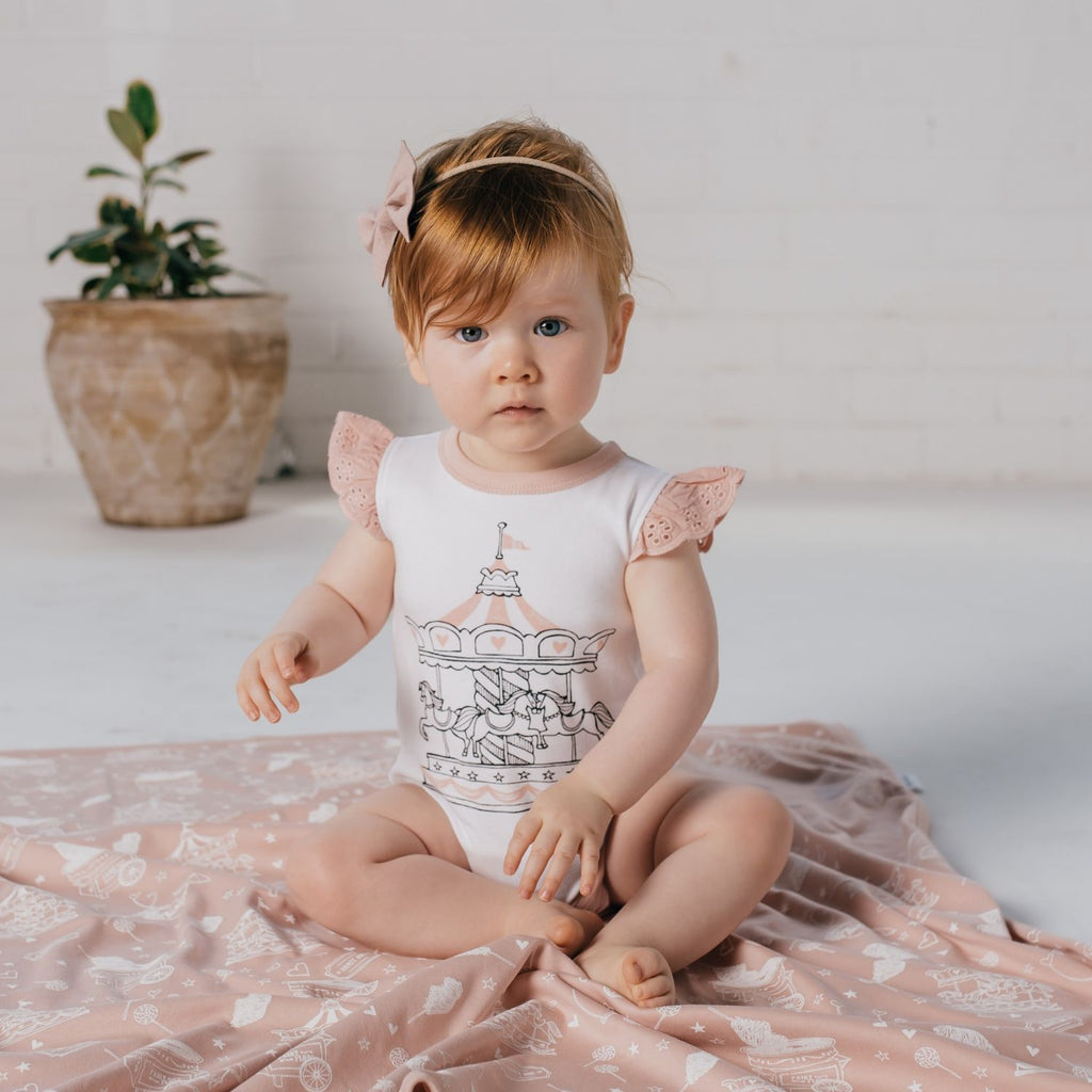peach carousel romper with flutter sleeves by aster & oak