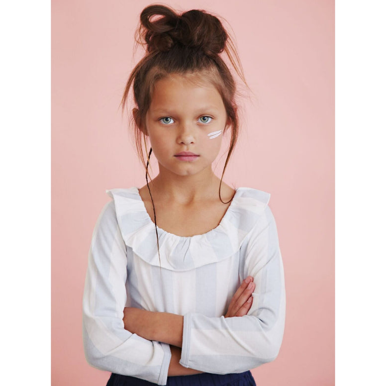 girl wearing anarkid block stripe grey blue frill neck leotard