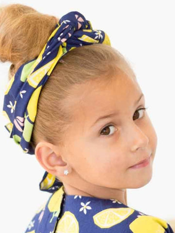 girl wearing navy headscarf with oobi's lucky lemonade print