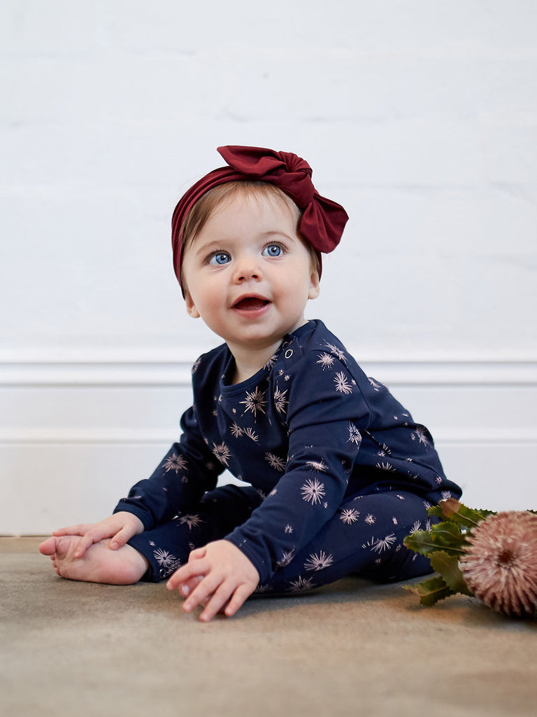baby girl in blue navy romper by mad about mini