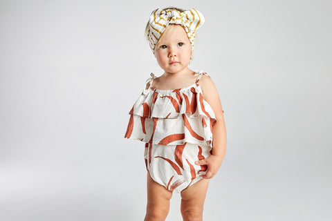 baby girl wearing mad about mini tiered ruffle romper