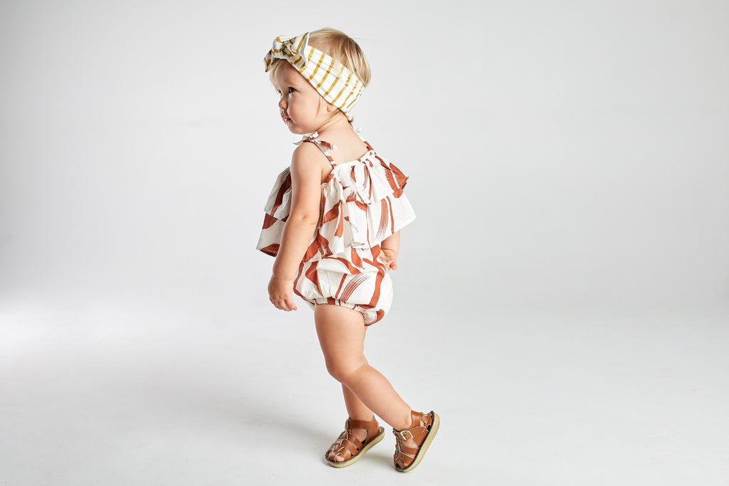 baby girl romper mad about mini terracotta paint stripe