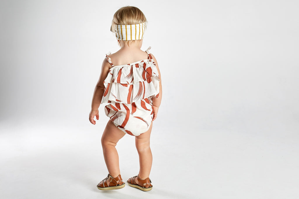 toddler weraing mad about mini organic cotton romper