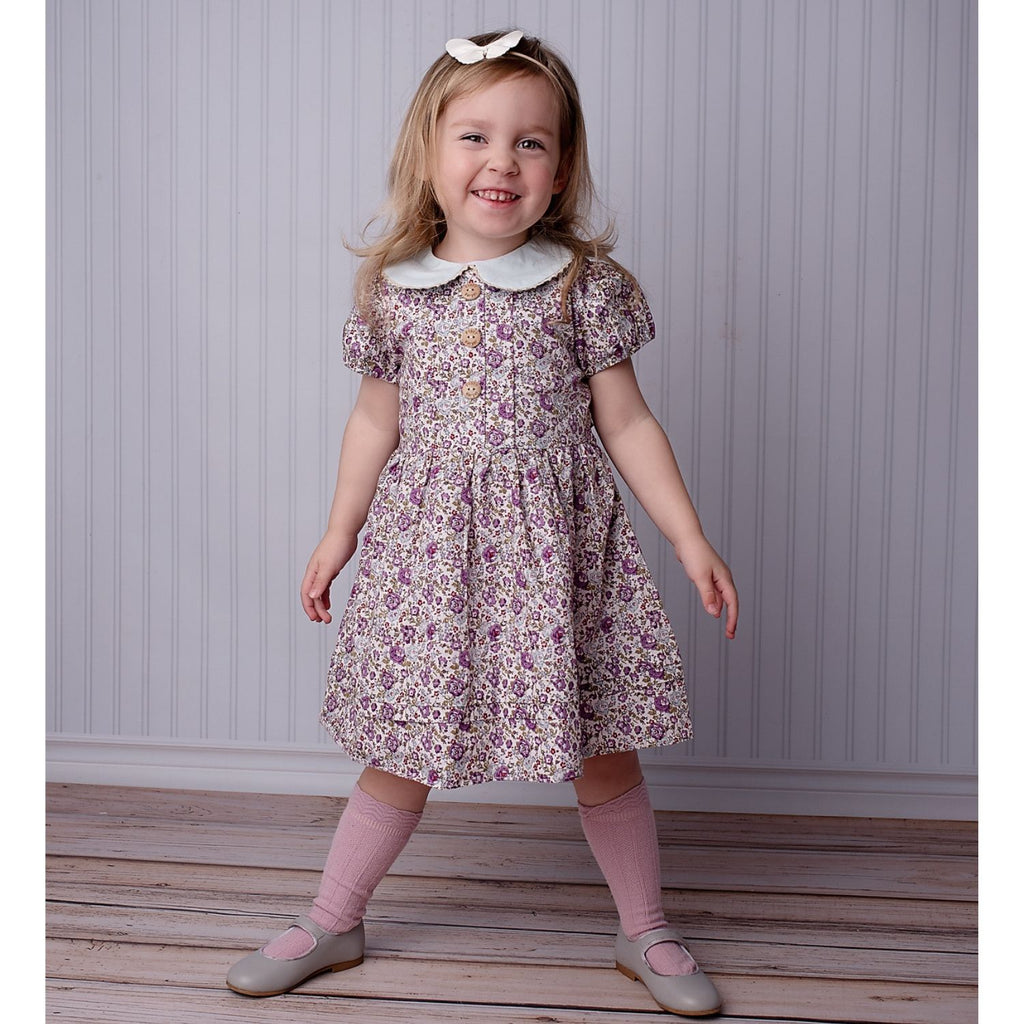 girl wearing poppy harper the label purple floral vintage style dress