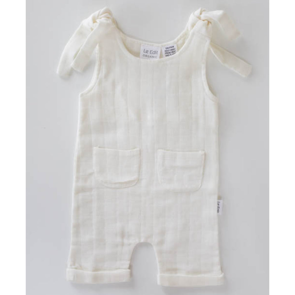 le edit viggo white baby romper with ties at the shoulders