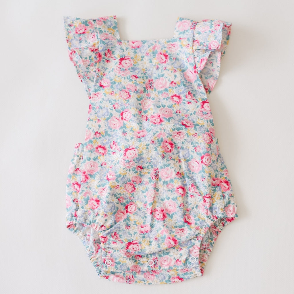 front of two darlings baby romper floral with flutter sleeves