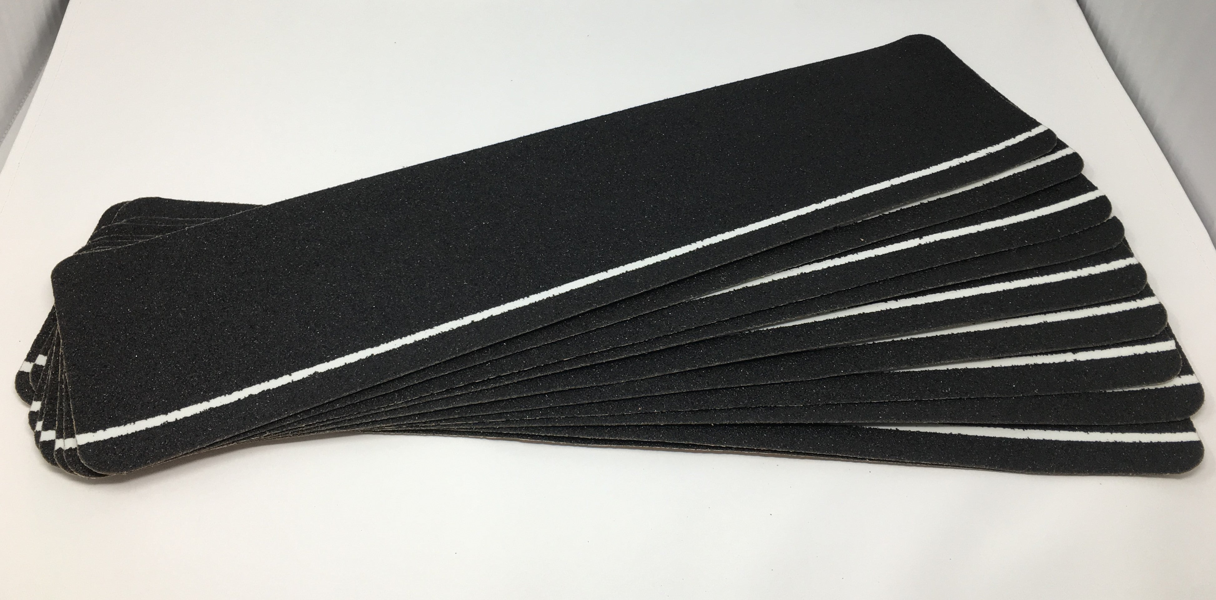 "6"" X 24"" Package of 50 Abrasive Non-Skid Stair Treads Black with Glow in the Dark Stripe"