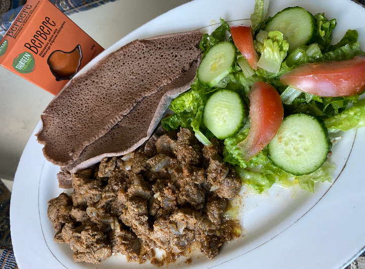 Beef stew with injera & salad