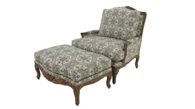 the Carved chair & ottoman is available in Edmonton at McElherans Furniture + Design