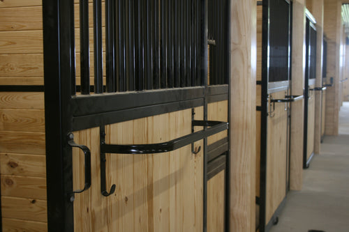 Blanket bar mounted on stall door