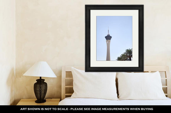 Framed Print, Stratosphere Tower And Palm Trees In Las Vegas Nevada
