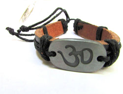 Silver tone Om yoga symbol metal charm engraved and black leather adjustable bracelet.
