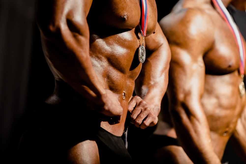 bodybuilders with medals winners at bodybuilding competitions