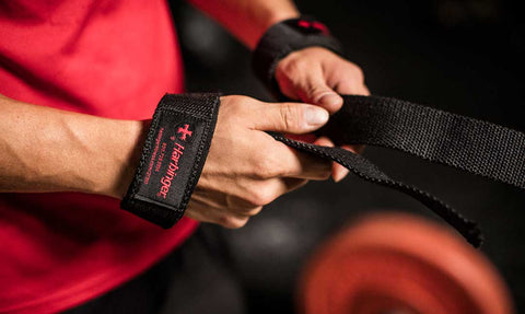 A person wearing lifting straps.
