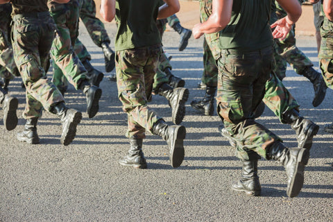 Group of soldiers running in uniform.