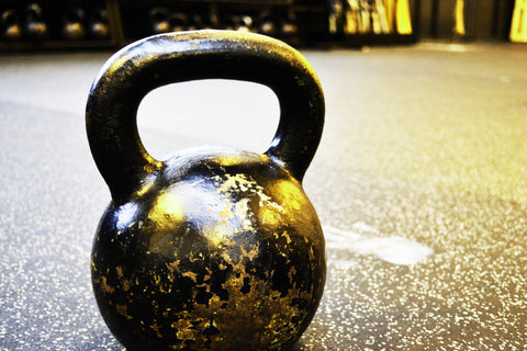 A kettle bell on the ground.