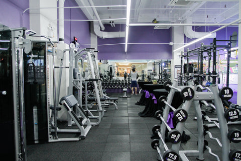 A gym with lots of weights.