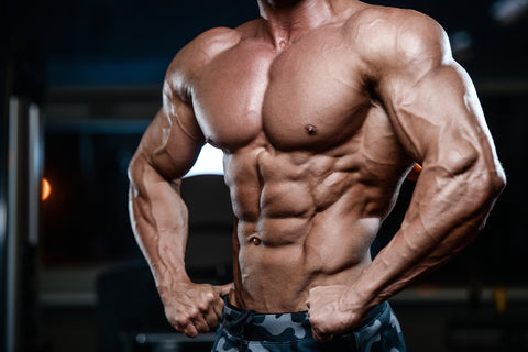 muscular man in gym with naked torso
