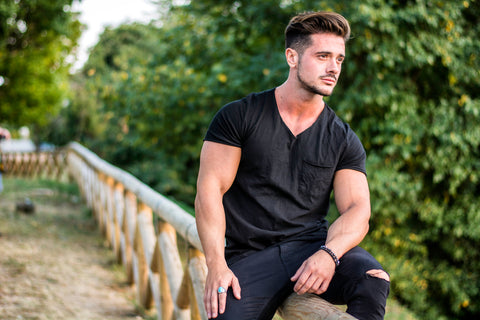 muscular man in a city park on a nice summer day