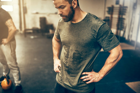 A man sweating in a gym.