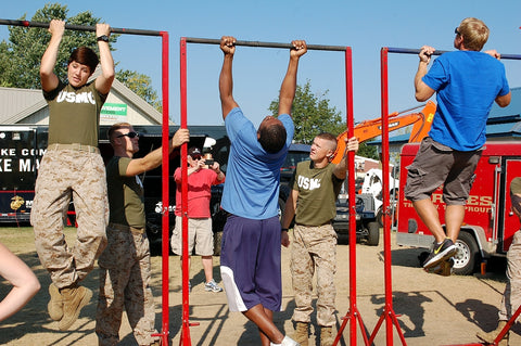 Unidentified members of the US Marines test fair-goers for fitness at the Minnesota State Fair