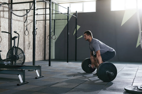 A man doing barbell rows.