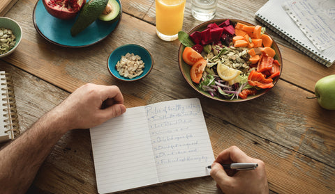 A person keeping track of food in a food diary.