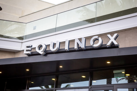 A store front sign for the upscale gym known as Equinox