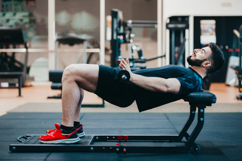 Man training glutes in the gym