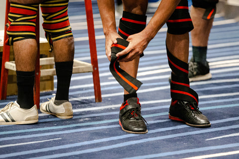 powerlifter in knee wraps at powerlifting competition