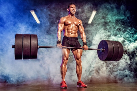 Strong Muscular Men Performing Heavy Deadlift Exercise With Barbells