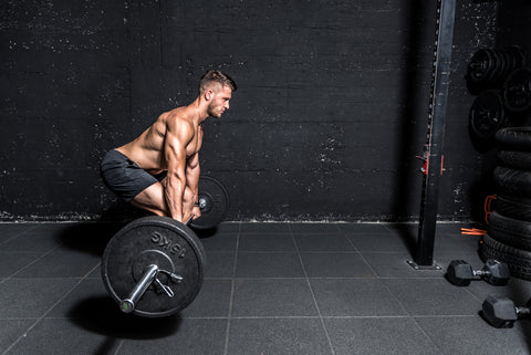 muscular sweaty man with big muscles doing deadlifts