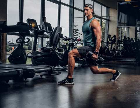 man doing lunges in a gym