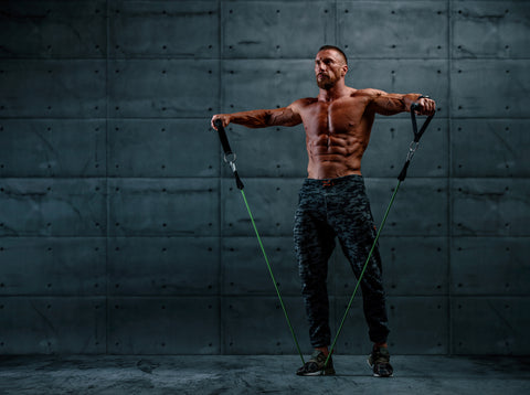 Muscular Athletic Men Exercise With Resistance Band
