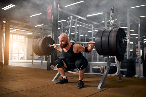 strong powerlifter training in gym