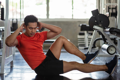 Asian Athlete muscle man doing bicycle crunch