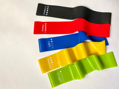 Set of bright multi-colored latex rubber bands for fitness