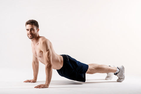 A man on a white background does an exercise on stretching his back. straight loin yoga exercise.