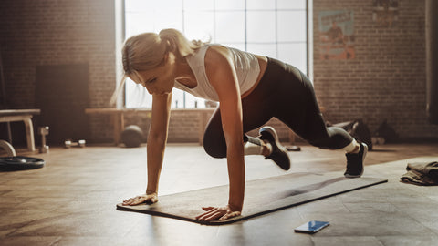 Woman Does Mountain Climber Workout in Stylish Hardcore Gym